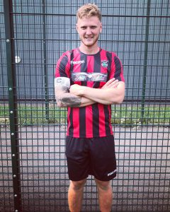 Tom Hughes posing with the new kit for KRFC